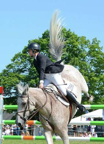 "Hannah Isop rides ""Keep It Simple"" at the 82nd annual Ox Ridge Charity Horse Show June 17, 2012, in Darien, Conn. Photo by Jeanna Petersen Shepard Photo: Contributed Photo"