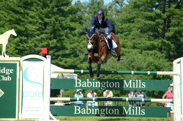 "Mattias Tromp rides ""Casey"" at the 82nd annual Ox Ridge Charity Horse Show June 17, 2012, in Darien, Conn. He placed fifth in the grand prix event. Photo by Jeanna Petersen Shepard Photo: Contributed Photo"