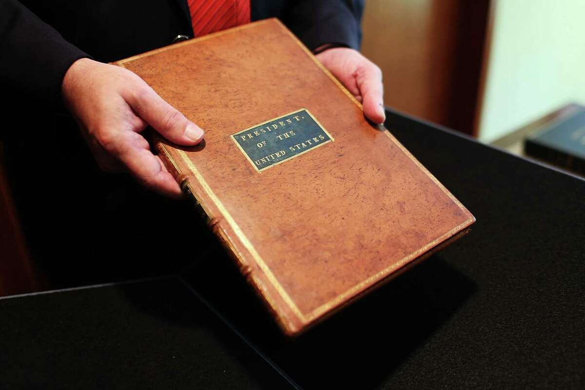 NEW YORK, NY - JUNE 15: A copy of former President George Washington's personal copy of the Constitution and Bill of Rights is viewed at Christie's auction house on June 15, 2012 in New York City. The artifact, which is signed and has notes by Washington, will be put up for auction on June 22 and is expected to sell for $2 million to $3 million.