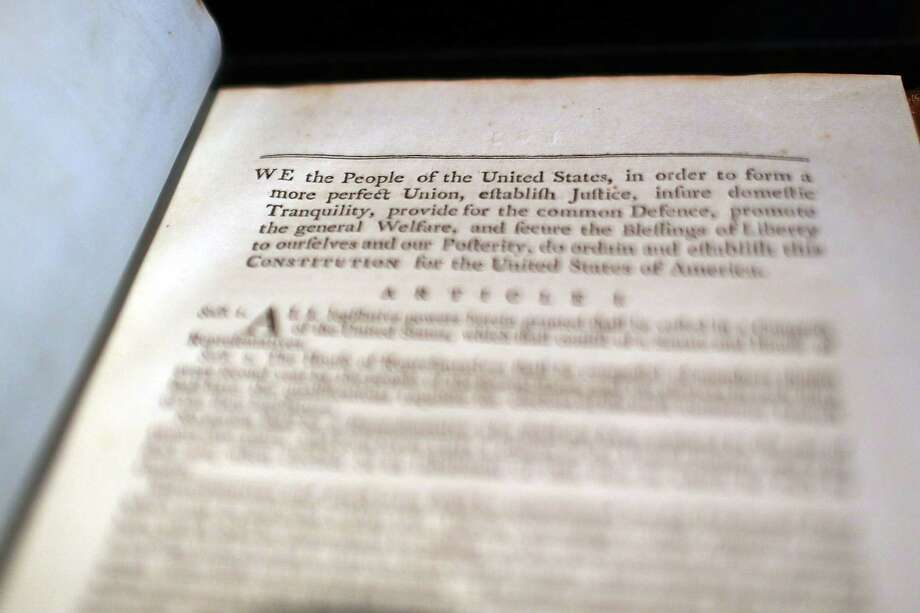 NEW YORK, NY - JUNE 15:  A copy of former President George Washington's personal copy of the Constitution and Bill of Rights is displayed at Christie's auction house on June 15, 2012 in New York City. The artifact, which is signed and has notes by Washington, will be put up for auction on June 22 and is expected to sell for $2 million to $3 million. Photo: Spencer Platt, Getty Images / 2012 Getty Images