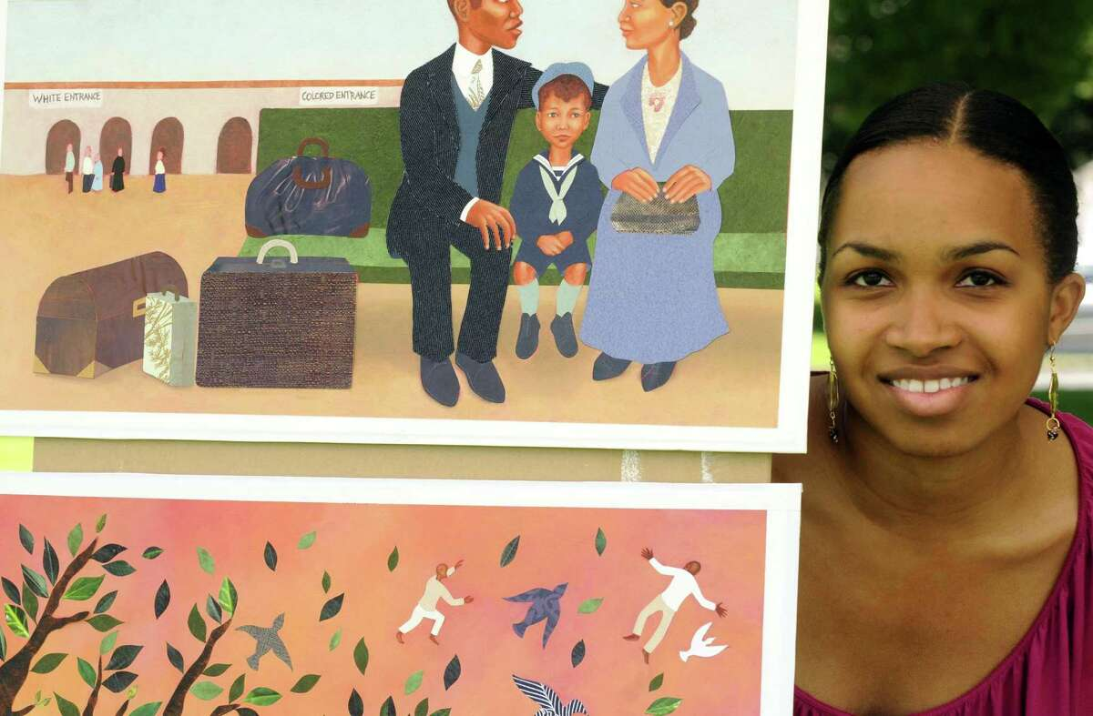 Artist and chilldren's book author Elizabeth Zunon at her display booth during the 8th Annual Albany Juneteenth Celebration at Washington Park in Albany N.Y. Saturday June 16, 2012. (Michael P. Farrell/Times Union)