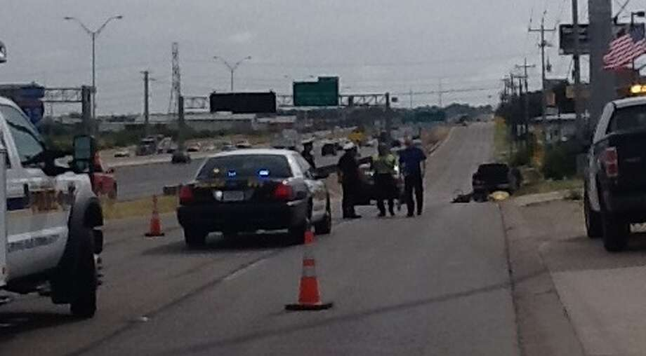 Police investigate the scene of a fatal bicycle accident along the northbound Interstate 35 access road near O'Connor Road about 9 a.m. on Monday. Photo: Ana Ley/Express-News