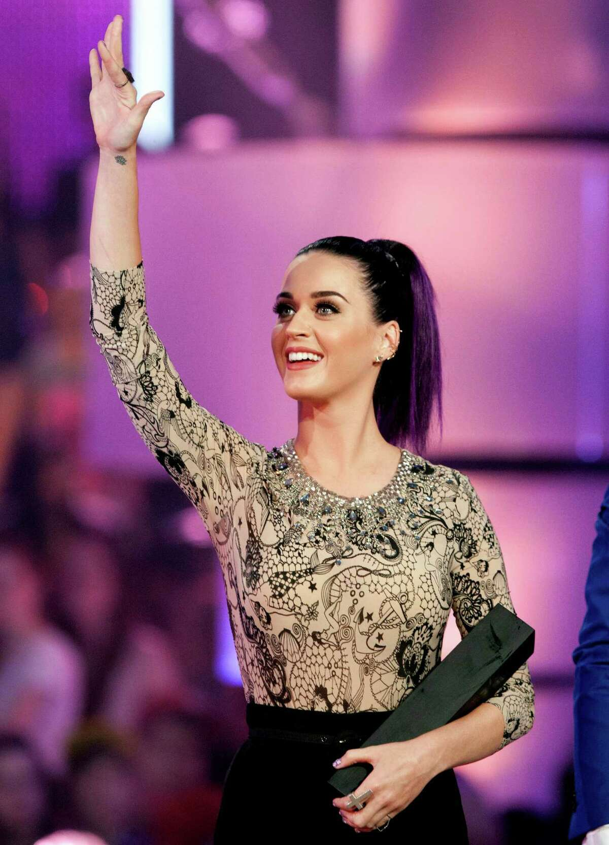 Katy Perry waves after receiving her award for Best International Video during the 2012 MuchMusic Video Awards in Toronto on Sunday (AP Photo/The Canadian Press, Chris Young)