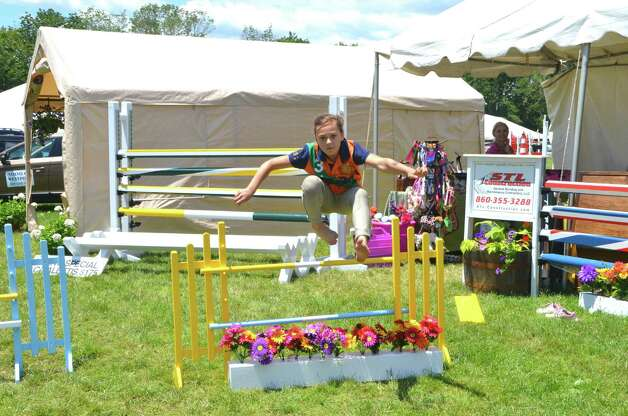 The riders aren't the only ones competing.  Maddie Wright cleared this jump with ease!  Ox Ridge Hunt Club Charity Horse Show, Saturday, June 16, 2012, Darien, Conn. Photo: Jeanna Petersen Shepard