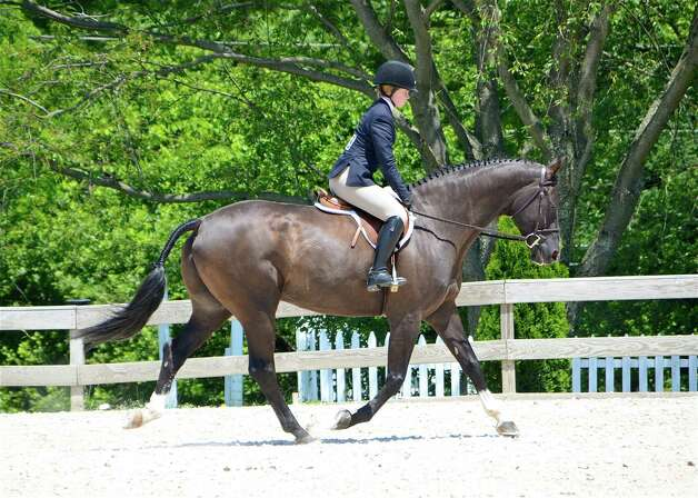 Molly McQuilken of New Canaan competes in the Childrens Hunter Hack at the Ox Ridge Hunt Club Charity Horse Show in Darien, Connecticut on Saturday, June 16, 2012. Photo: Jeanna Petersen Shepard