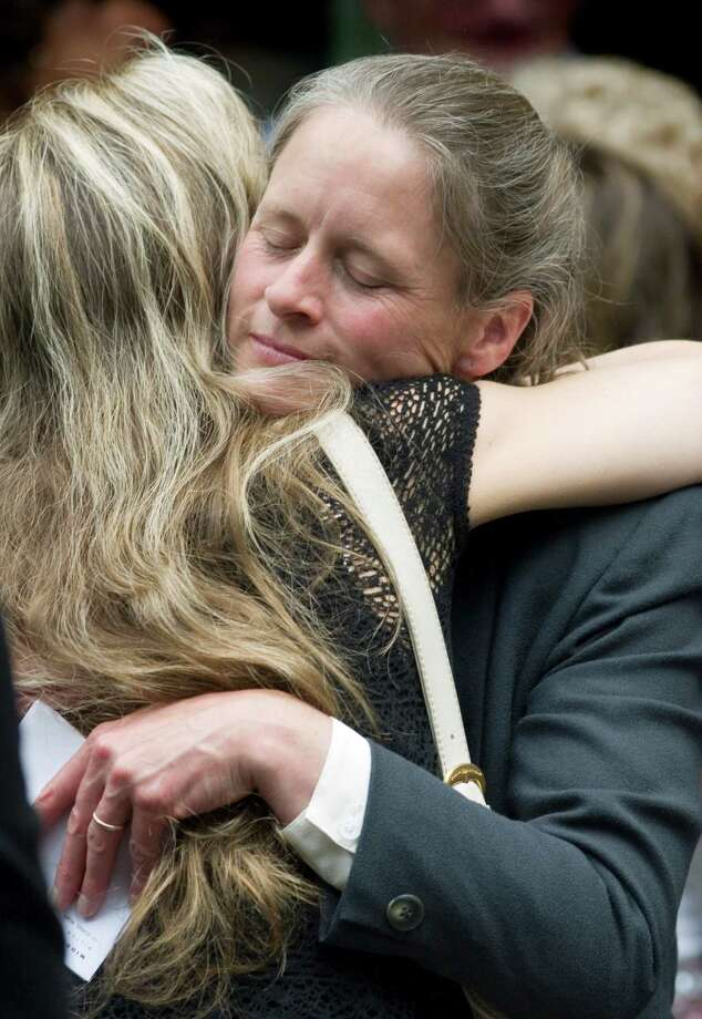 File 2008: Kate Throckmorton, right, receives a hug following the services for her son, Nicholas Parisot, who died in a off-road motorcycle accident on June 13. The service was held at Unitarian Church of Westport. Photo: Kerry Sherck / Stamford Advocate