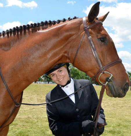 "Alexandra Murphy from Larkspur Stables in Wilton, with her horse ""Campino"" at the Ox Ridge Charity Horse Show on Saturday, June 16, 2012 in Darien, Conn. Photo: Jeanna Petersen Shepard"