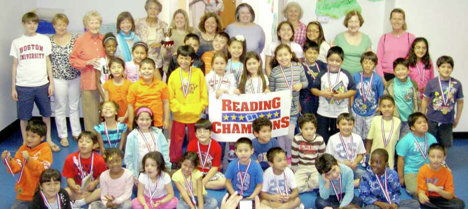 Forty graduates and tutors celebrate their successful participation in Greenwich United Way's Reading Champions tutoring program at Byram Archibald Neighborhood Center earlier this month.  Co-founder Joan Lowe, who coordinates all volunteers, is standing fifth from left. Photo: Contributed Photo