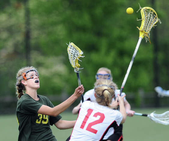 At left, Mary Taussig # 39 of Greenwich Academy passes while being covered by Claire O'Callaghan # 12 of Rye High School during girls high school lacrosse match between Rye High School and Greenwich Academy at Greenwich Academy, Saturday afternoon, May 5, 2012. Rye defeated GA, 12-11. Photo: Bob Luckey / Greenwich Time
