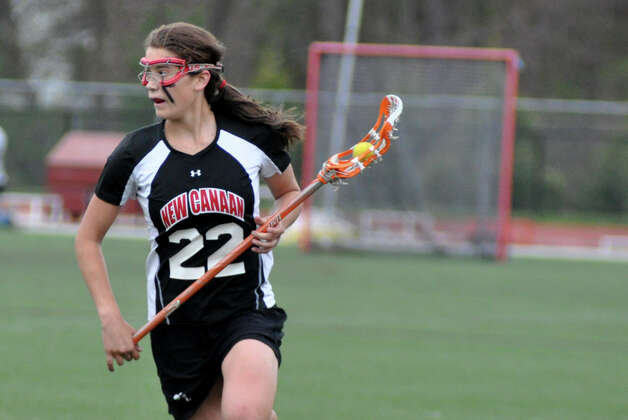 New Canaan's Olivia Hompe (22) controls the ball during the girls lacrosse game against Darien at Darien High School on Wednesday, Apr. 18, 2012. Photo: Amy Mortensen