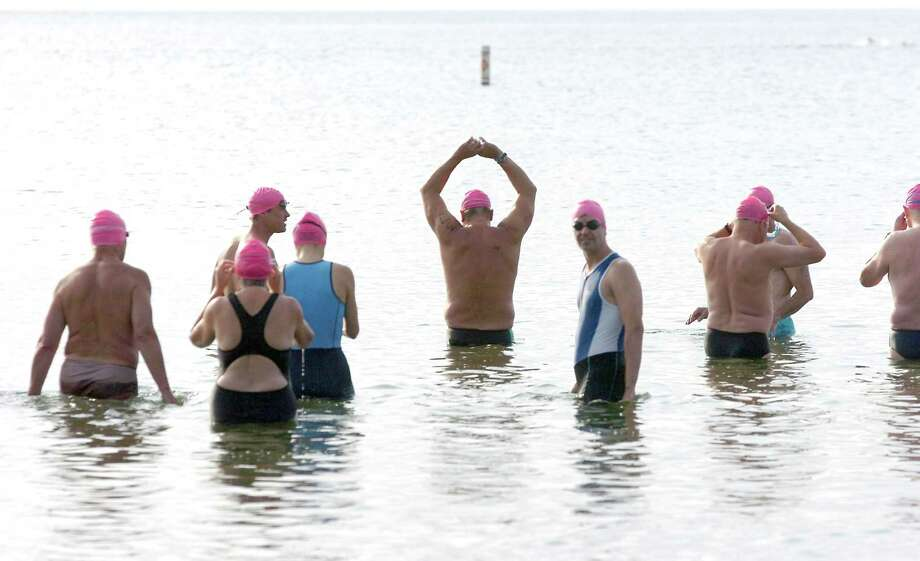 The 25th Annual Greenwich Point One Mile Swim will be held on July 14. Above, swimmers line up for the start of a previous One Mile Swim. Photo: Keelin Daly / Greenwich Time, File Photo / Greenwich Citizen