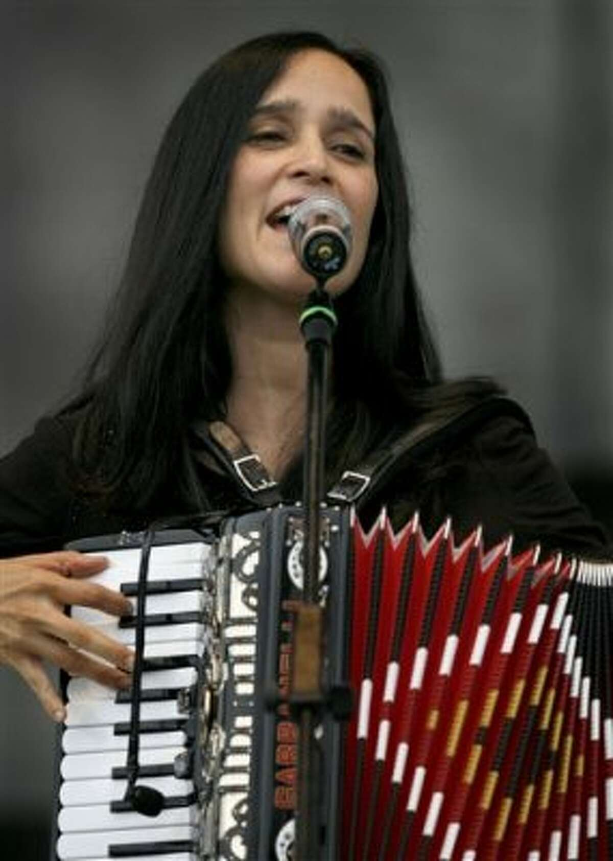 """Mexican musician Julieta Venegas performs during a music festival in support of the student movement #YoSoy132, or """"I am 132"""" in Mexico City, Saturday June 16, 2012. #YoSoy132 is the name of a university movement that rejects the possible return of the old ruling Institutional Revolutionary Party (PRI) ahead of Mexico's July 1 presidential election. (AP Photo/Marco Ugarte) (AP)"""