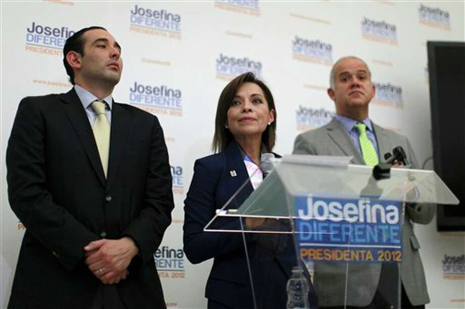 Presidential candidate Josefina Vazquez Mota of the National Action Party (PAN), center, pauses during a news conference at her campaign headquarters in Mexico City, Wednesday, June 6, 2012. At left is her campaign manager Roberto Gil Zuarth and at right is her new spokesman Juan Ignacio Zavala. Next July 1, Mexico will hold presidential elections. (AP Photo/Dario Lopez-Mills) (AP)