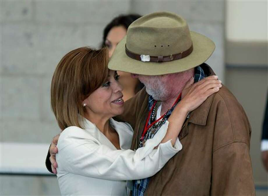 Josefina Vazquez Mota, left, presidential candidate for the now-governing National Action Party, PAN, and Mexican poet Javier Sicilia, leader of the Movement for Peace with Justice and Dignity, embrace during a meeting between family members of victims of drug gang-related violence at Chapultepec Castle in Mexico City, Monday, May 28, 2012. Vazquez Moto was the first of the four presidential candidates scheduled to meet with Sicilia and representatives of his movement Monday. Mexico will hold presidential elections on July 1. (AP Photo/Eduardo Verdugo) (AP)