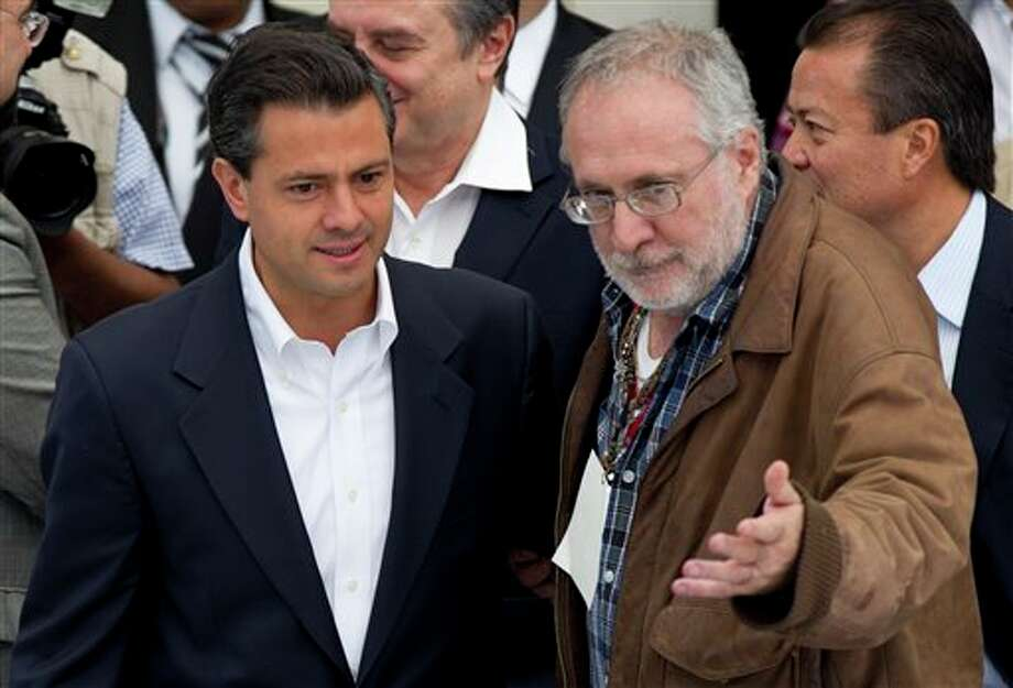 Enrique Pena Nieto, presidential candidate for the Institutional Revolutionary Party, PRI, left, is greeted by Mexican poet Javier Sicilia, leader of the Movement for Peace with Justice and Dignity, upon his arrival to a meeting with Sicilia and family members of victims of drug gang-related violence at Chapultepec Castle in Mexico City, Monday, May 28, 2012. Pena Nieto was the second of the four presidential candidates to meet with Sicilia and representatives of his movement Monday. Mexico will hold presidential elections on July 1. (AP Photo/Eduardo Verdugo) (AP)