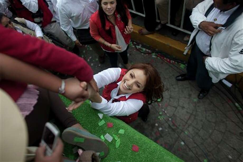 Mexican actress Angelica Rivera de Pena, wife of Presidential candidate Enrique Pena Nieto, of the Institutional Revolutionary Party, greets supporters during a campaign rally in Atlacomulco, Mexico, Sunday, June 17, 2012. Mexico will hold presidential elections on July 1. (AP Photo/Alexandre Meneghini) (AP)
