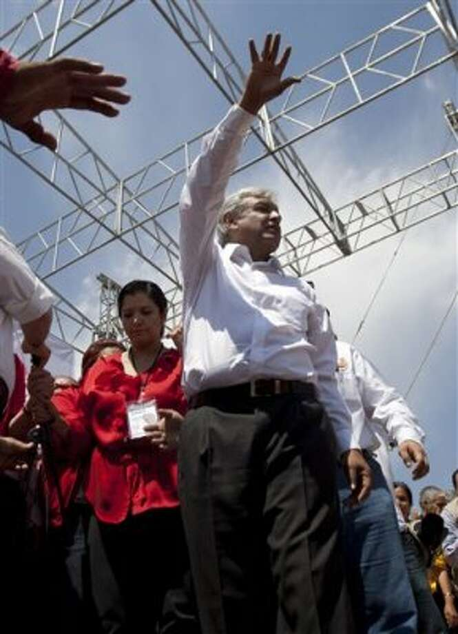 Andres Manuel Lopez Obrador, presidential candidate for the Democratic Revolution Party, PRD, waves to supporters during a campaign rally in Cuautitlan Izcalli, Mexico,  Wednesday, June 6, 2012. Mexico will hold presidential elections on July 1. (AP Photo/Eduardo Verdugo) (AP)