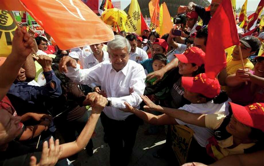 Andres Manuel Lopez Obrador, presidential candidate for the Democratic Revolution Party, PRD, greets supporters at a campaign rally in Cuautitlan Izcalli, Mexico,  Wednesday, June 6, 2012. Mexico will hold presidential elections on July 1. (AP Photo/Eduardo Verdugo) (AP)