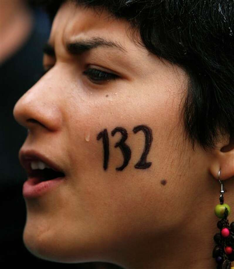 "A youth attends a music festival in support of the student movement #YoSoy132, or ""I am 132"" in Mexico City's Zocalo plaza, Saturday June 16, 2012. #YoSoy132 is the name of a university movement that rejects the possible return of the old ruling Institutional Revolutionary Party (PRI) ahead of Mexico's July 1 presidential election. (AP Photo/Marco Ugarte) Photo: Associated Press"