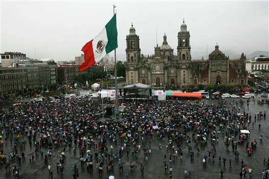 "People gather for a music festival in support of the student movement #YoSoy132, or ""I am 132"" in Mexico City's Zocalo plaza, Saturday June 16, 2012. #YoSoy132 is the name of a university movement that rejects the possible return of the old ruling Institutional Revolutionary Party (PRI) ahead of Mexico's July 1 presidential election. (AP Photo/Marco Ugarte) Photo: Associated Press"