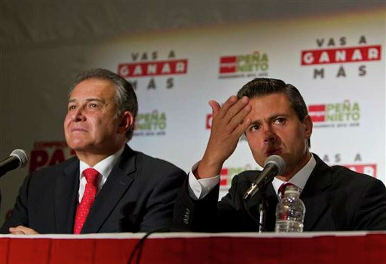 Presidential candidate Enrique Pena Nieto, right, of the Institutional Revolutionary Party and Colom