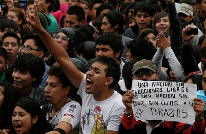 Youths attend a music festival in support of the student movement #YoSoy132, or