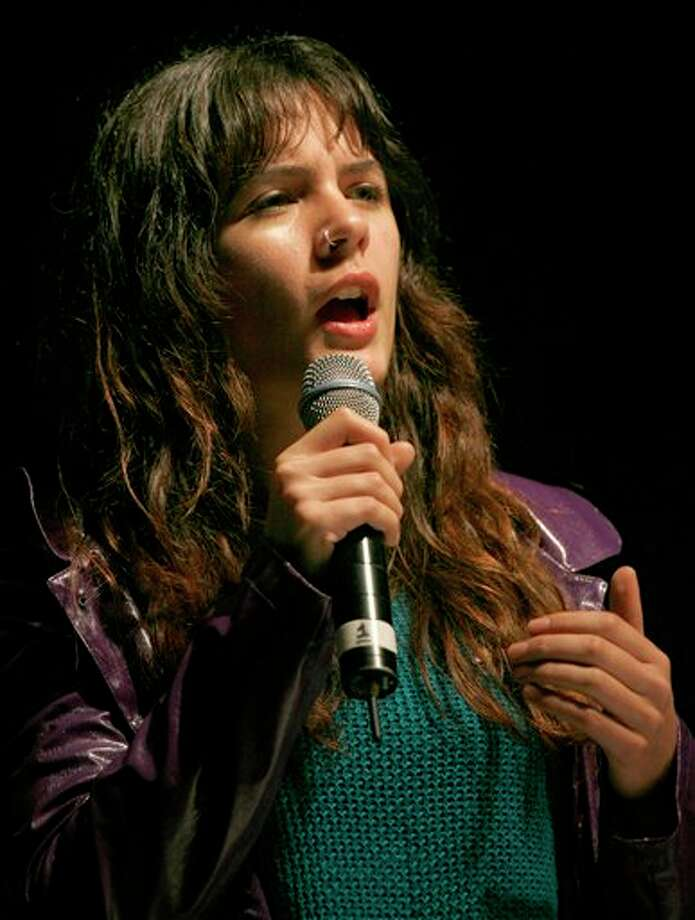 """Chile's student leader Camila Vallejo speaks during a music festival in support of the student movement #YoSoy132, or """"I am 132"""" in Mexico City's Zocalo plaza, Saturday June 16, 2012. #YoSoy132 is the name of a university movement that rejects the possible return of the old ruling Institutional Revolutionary Party (PRI) ahead of Mexico's July 1 presidential election. (AP Photo/Marco Ugarte) Photo: Associated Press"""