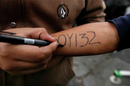 "A man writes on his arm ""Soy132"" during a music festival in support of the #YoSoy132, or ""I am 132"" student movement in Mexico City, Saturday June 16, 2012. #YoSoy132 is the name of a university movement that rejects the possible return of the old ruling Institutional Revolutionary Party (PRI) ahead of Mexico's July 1 presidential election. (AP Photo/Marco Ugarte) Photo: Associated Press"
