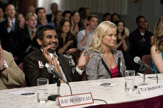 "PARKS AND RECREATION -- ""Beauty Pageant"" Episode 203 -- Pictured: (l-r) Aziz Ansari as Tom Haverford, Amy Poehler as Leslie Knope Photo: Paul Drinkwater, NBC Universal, Inc."