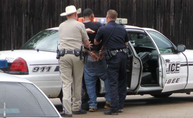 Four persons were arrested after an aggravated robbery in the Silsbee Wal Mart parking lot on Monday, June 18. Two of the suspects demanded money from a 72-year-old man while threatening him with a knife. Photo: David Lisenby, HCN_6-18 Robbery