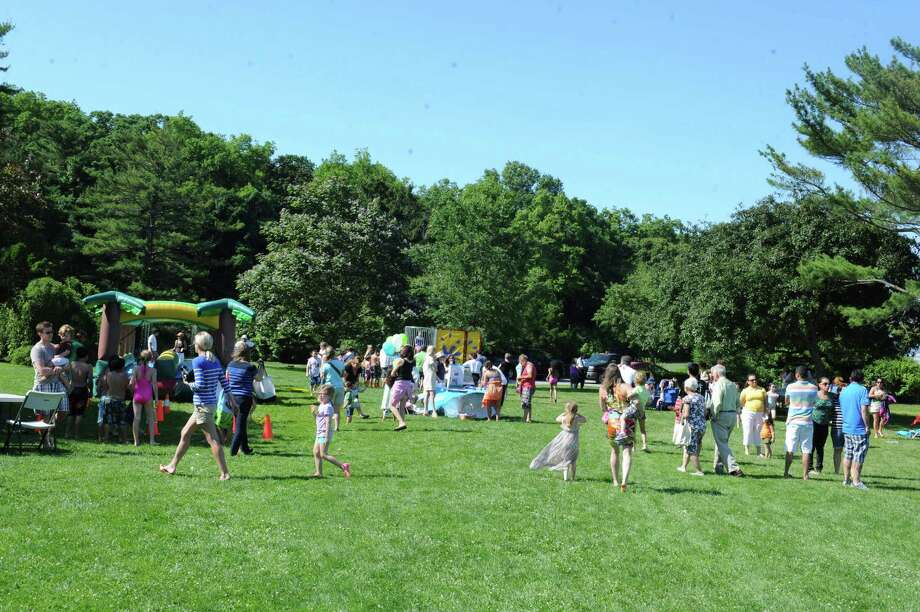 The Greenwich Family Fair in Byram Park hosted by Junior League of Greenwich Sunday, June 17, 2012. In cooperation with the town, the Junior League is working to build a new community pool in Byram Park. Photo: Helen Neafsey / Greenwich Time