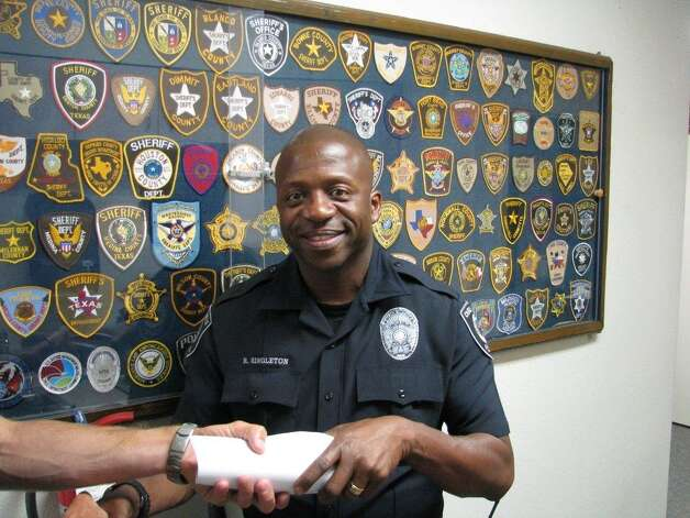 Castle Hills' newest police officer, Ronald Singleton, was formally sworn into active duty by local officials earlier this month. Photo: Courtesy Photo