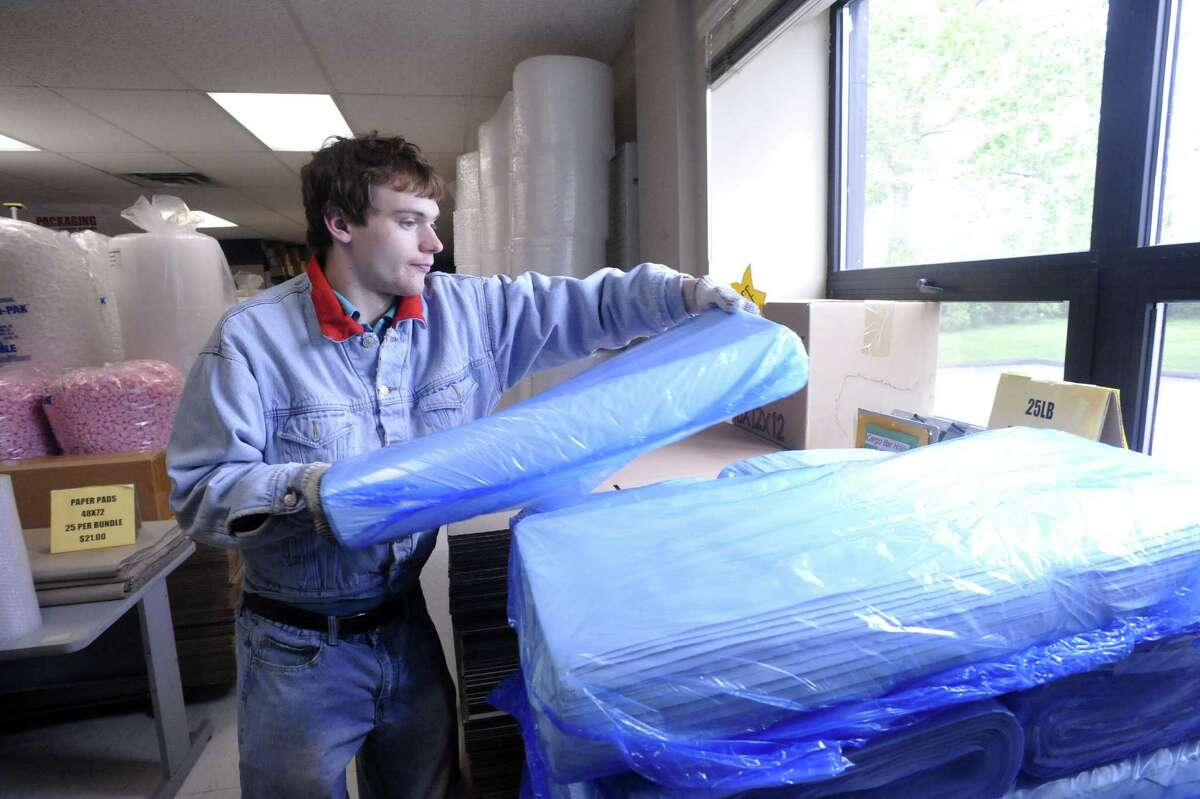 Benjamin Getchell, 21, works with packing materials at Clayton's Mercantile Supply, Inc. & Connecticut Carton & Packing, in New Milford Thursday, May 10, 2012.
