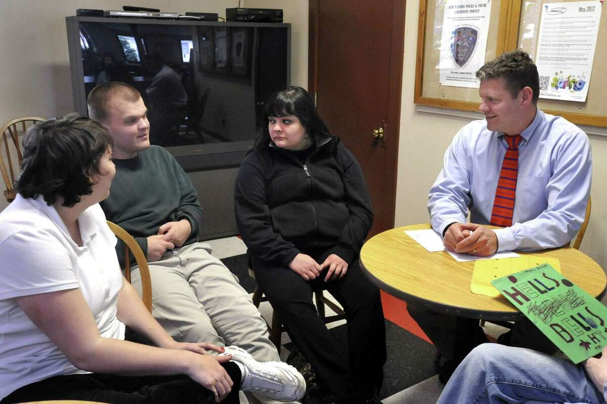 Anthony Molles, 20, talks to transition teacher Dave Hawthorne, right, during a meeting at the Litchfield Hills Transition Center Thursday, May 10, 2012. Michelle Espadas, 18, center, listens.