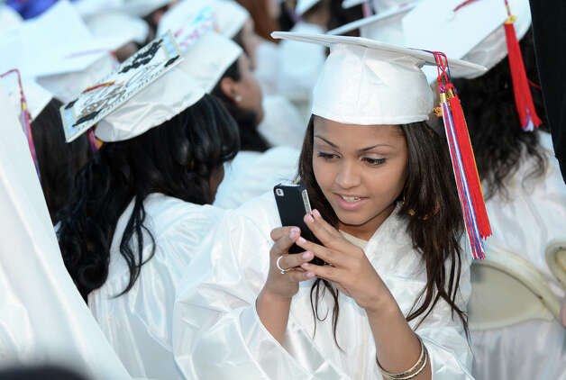 Graduate Crystal Jaboin takes a photo of a classmate during the fifty-first commencement excercises at Brien McMahon High School in Norwalk on Friday, June 15, 2012. Photo: Amy Mortensen / Connecticut Post Freelance