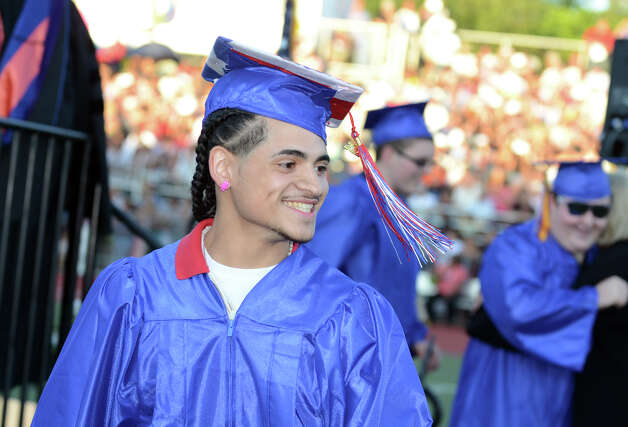 Graduate Abel Gonzalez smiles after receiving his diploma during the fifty-first commencement excercises at Brien McMahon High School in Norwalk on Friday, June 15, 2012. Photo: Amy Mortensen / Connecticut Post Freelance