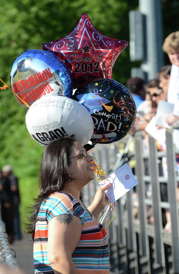 Lydia Rivera carries a bunch of balloons for her son, graduate Elijah Rivera, during the fifty-first commencement excercises at Brien McMahon High School in Norwalk on Friday, June 15, 2012. Photo: Amy Mortensen / Connecticut Post Freelance
