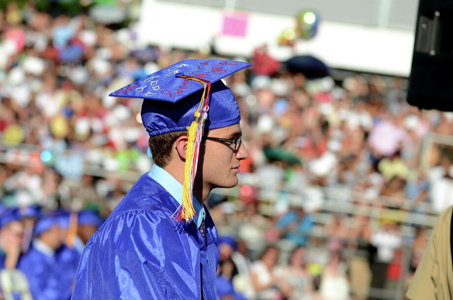 Christopher Madaffari, Senior Class President and Salutatorian, walks up to the podium to address his classmates during the fifty-first commencement excercises at Brien McMahon High School in Norwalk on Friday, June 15, 2012. Photo: Amy Mortensen / Connecticut Post Freelance