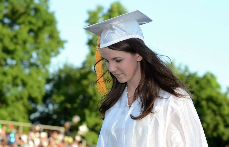 Katherine Buellesbach, Valedictorian, walks to her seat after addressing her classmates during the fifty-first commencement excercises at Brien McMahon High School in Norwalk on Friday, June 15, 2012. Photo: Amy Mortensen / Connecticut Post Freelance