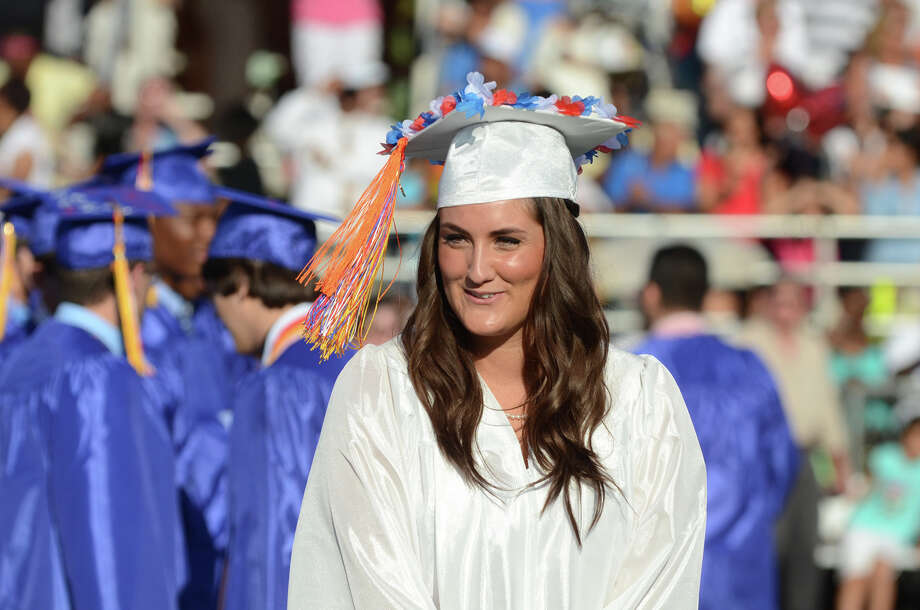 Graduate Carly Cardovano walks up to the podium to call for a moment of remembrance during the fifty-first commencement excercises at Brien McMahon High School in Norwalk on Friday, June 15, 2012. Photo: Amy Mortensen / Connecticut Post Freelance