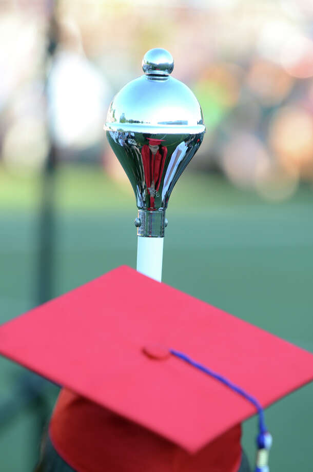 Junior Class President and Parade Marshal Paola Monsalve's image reflects in her scepter during the fifty-first commencement excercises at Brien McMahon High School in Norwalk on Friday, June 15, 2012. Photo: Amy Mortensen / Connecticut Post Freelance