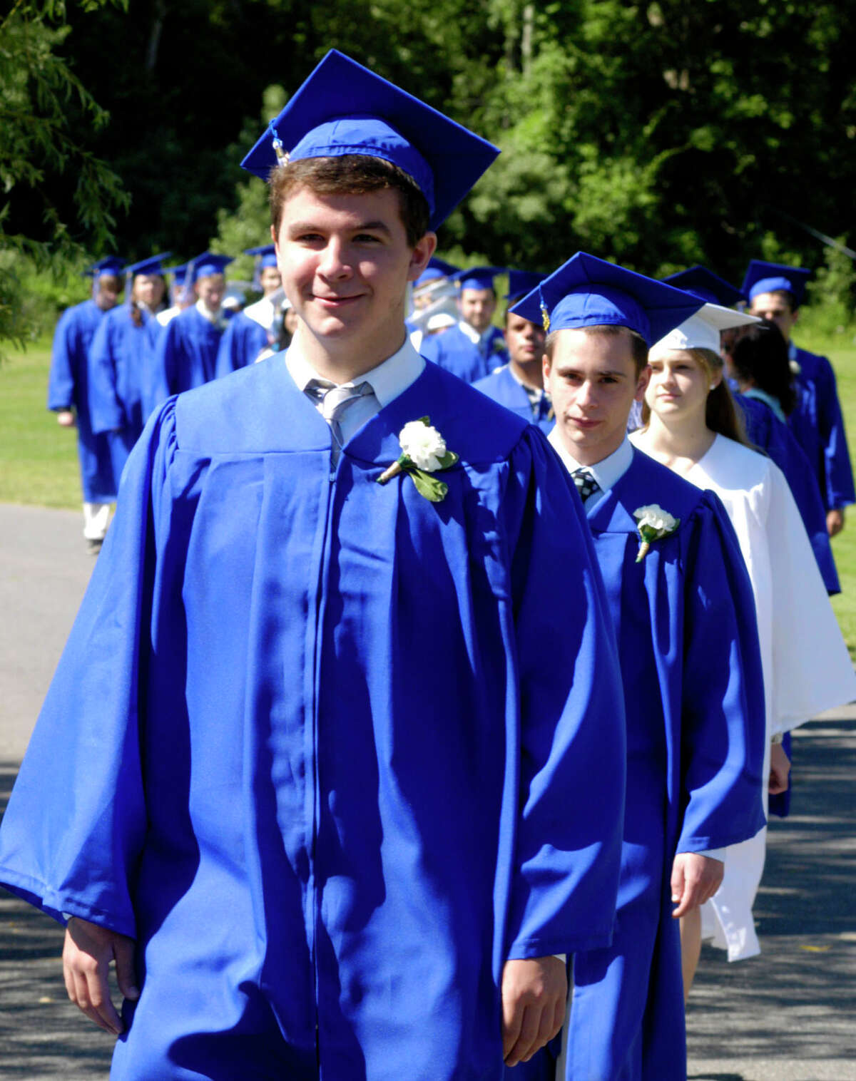Kyle Lundie, left, Shaun Lynch and classmates march in the processional for the Shepaug Valley High School Class of 2012 graduation ceremony, June 16, 2012, in Washington.