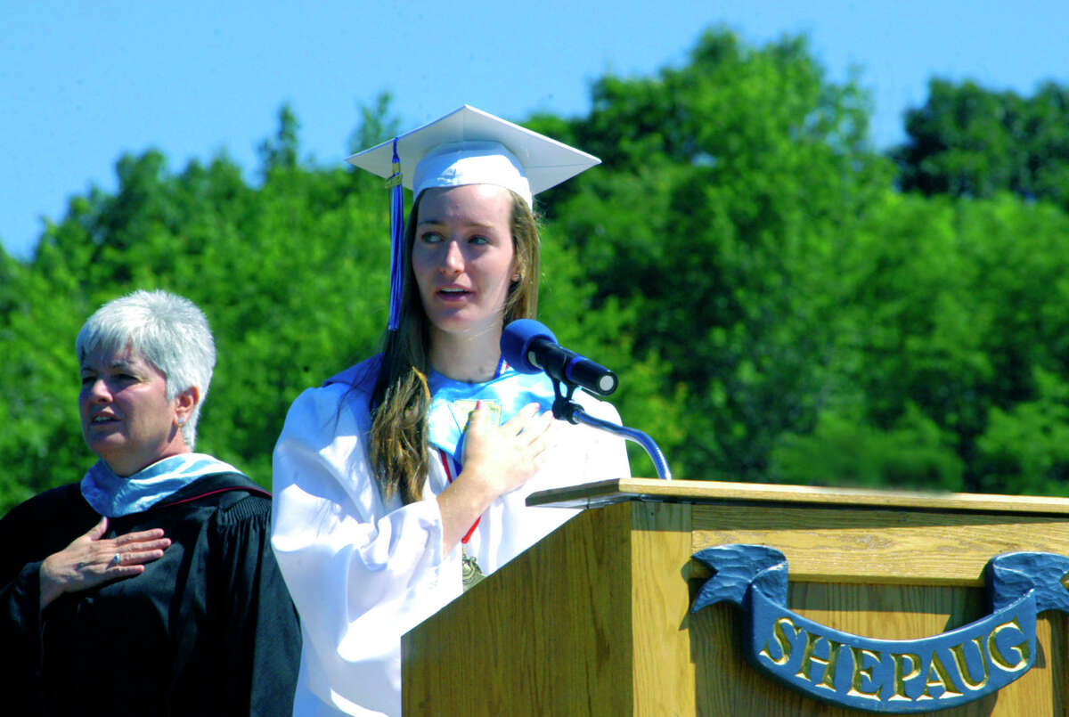 Class president Gina Demeo leads the Pledge of Allegiance for Principal Kim Gallo and hundreds more in attendance at the Shepaug Valley High School graduation ceremony, June 16, 2012, in Washington.
