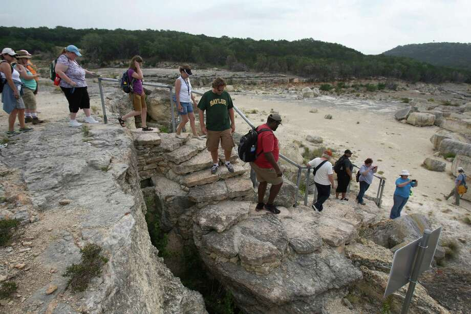 Teachers from the Texas Alliance For Geographic Education walk down steps leading to the gorge Wednesday June 13, 2012 at Canyon Lake. The gorge was created by the flooding along the Guadalupe River in 2002 but has recently become a popular tourist destination as the Gorge Preservation Society leads. Photo: Julysa Sosa, San Antonio Express-News / SAN ANTONIO EXPRESS-NEWS