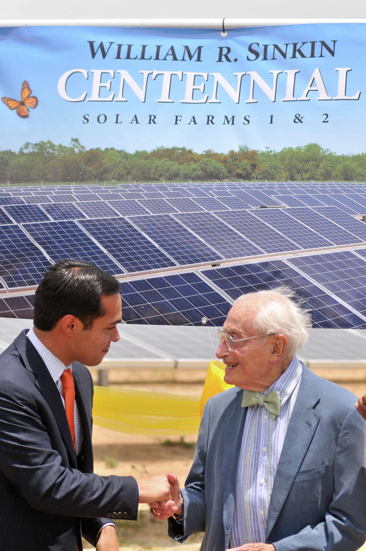 SLUG: Solar Farm-Photo Request 5776-June 18, 2012-San Antonio, Texas--Mayor Julian Castro (lrfy) congratulates solar power advocate William Sinkin during a ribbon cutting for a new, 20 mega-watt solar farm named after Sinkin.