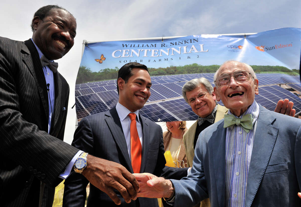 Solar power advocate, 99 year old William Sinkin (right), is congratulated by CPS CEO Doyle Beneby, Mayor Julian Castro, and SAWS Chairman Berto Guerra following the ribbon cutting at the new 20 Mega-Watt Solar Farm named after Sinkins. The event took place Monday afternoon.