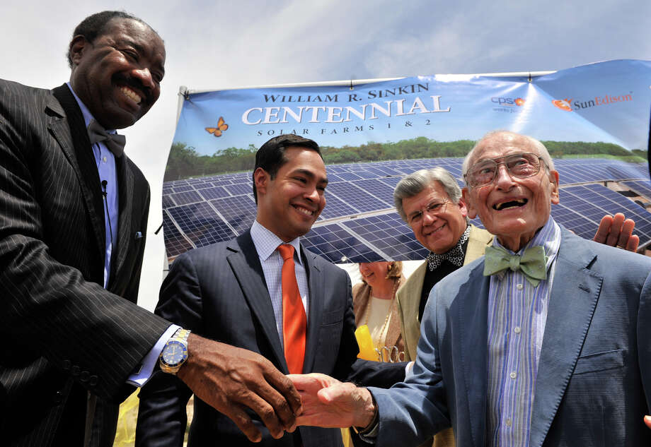 Solar power advocate, 99 year old William Sinkin (right), is congratulated by CPS CEO Doyle Beneby, Mayor Julian Castro, and SAWS Chairman Berto Guerra following the ribbon cutting at the new 20 Mega-Watt Solar Farm named after Sinkins. The event took place Monday afternoon. Photo: Robin Jerstad, FOR THE EXPRESS-NEWS / Robin Jerstad