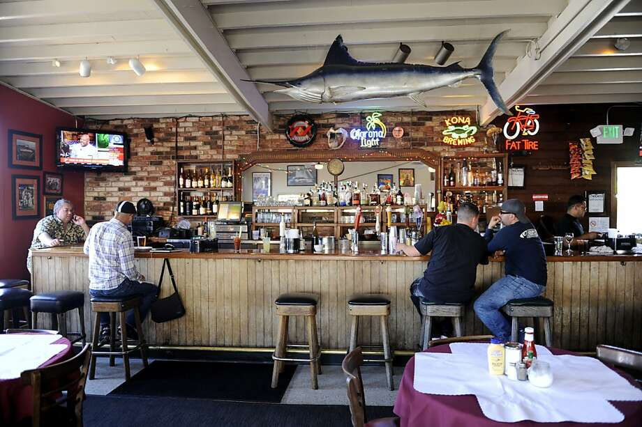 People dine at the indoor bar at the Ramp Restaurant and Bar. Weekend evenings feature live music and a special barbecue menu. Photo: Megan Farmer, The Chronicle
