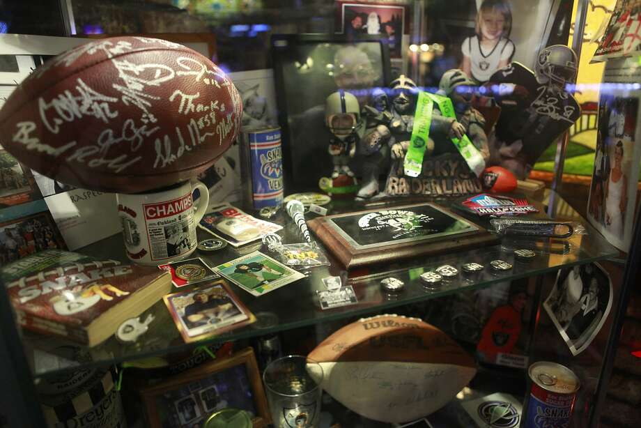 Sports memorabilia on display at Ricky's on Saturday, June 9th, 2012 in San Leandro, Calif. Photo: Jill Schneider, The Chronicle