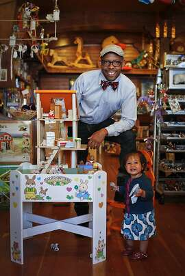 """Kenneth Wingard, host of OWN's, """"Home Made Simple,"""" and owner of SF home decor boutique, Kenneth Wingard, is seen with his daughter, Coco, 1, at The Ark toy store in San Francisco, Calif., on Friday, June 8, 2012."""